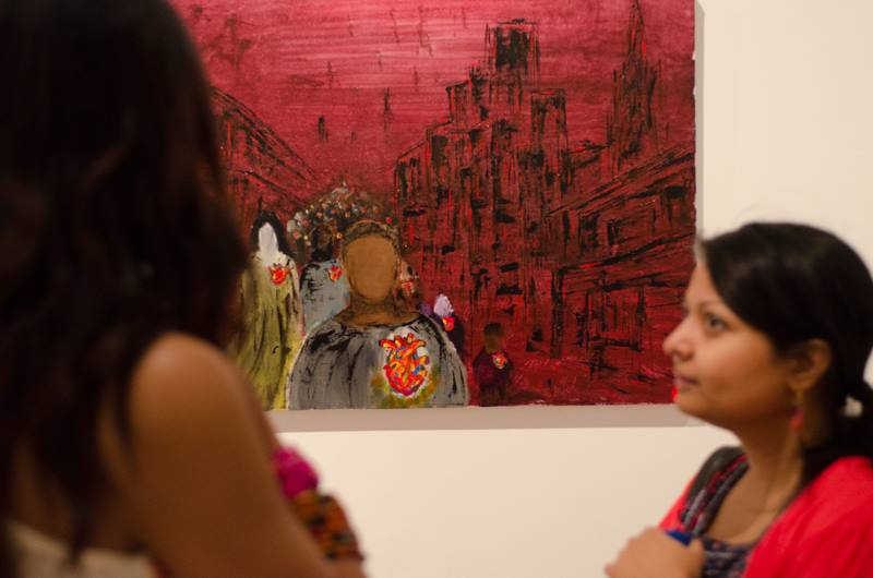 Zee Arts and I, in deep artful thoughtful discussions. Irfan's art is in the background